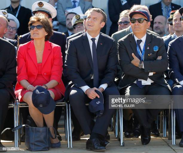 French President Emmanuel Macron French defense minister Sylvie Goulard and Dassault Aviation CEO Eric Trappier watch demonstration flights as part...