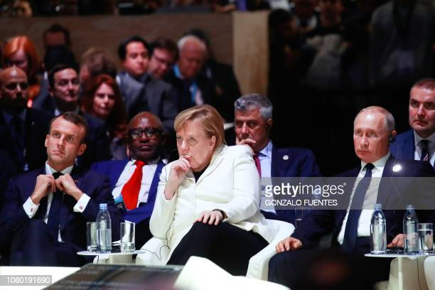 French President Emmanuel Macron German Chancellor Angela Merkel and Russian President Vladimir Putin attend the opening ceremony of the Paris Peace...