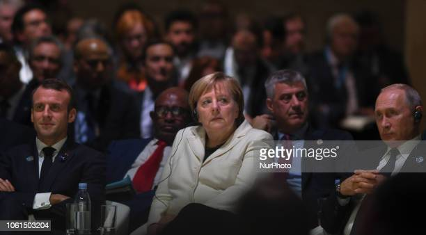 French President Emmanuel Macron German Chancellor Angela Merkel and Russian President Vladimir Putin at the opening session of the Paris Peace Forum...