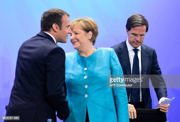 French President Emmanuel Macron German Chancellor Angela Merkel and Netherland's Prime Minister Mark Rutte talk after a press conference on June 29...
