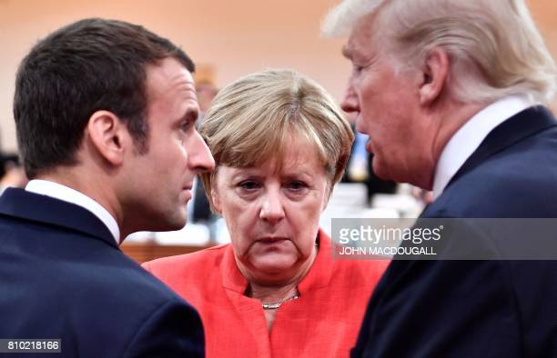 TOPSHOT French President Emmanuel Macron German Chancellor Angela Merkel and US President Donald Trump confer at the start of the first working...