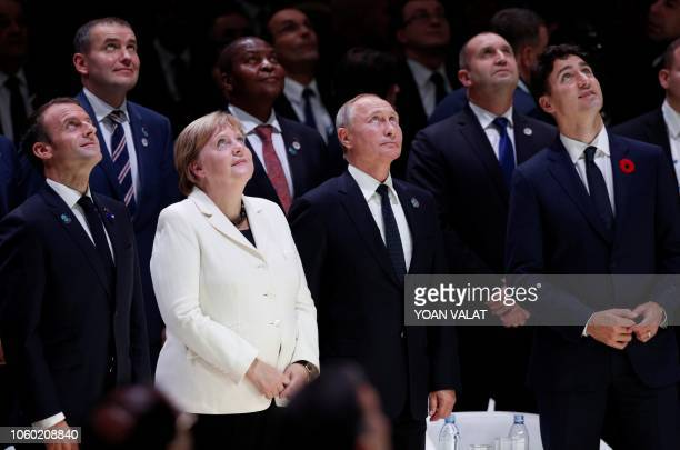 French President Emmanuel Macron German Chancellor Angela Merkel Russian President Vladimir Putin and Canadian Prime Minister Justin Trudeau look up...
