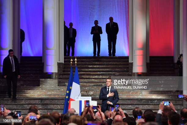 French President Emmanuel Macron gestures as he arrives to deliver a speech during a Frenchspeaking community reception at the BOZAR Centre for Fine...