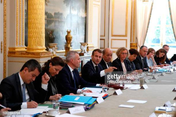 French President Emmanuel Macron gestures as he chairs the weekly cabinet meeting at the Elysee Palace on October 17 in Paris Macron made a rare...