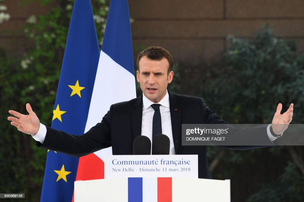 French President Emmanuel Macron gestures as he delivers a speech during a meeting with the French community resident in India at the French embassy in New Delhi on March 11, 2018. French President Emmanuel Macron on March 10 said he wanted his country to be India's best partner in Europe as he started a three-day trip to the country aimed at ratcheting up security and energy ties. /