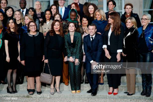 French President Emmanuel Macron gestures as he joins others including British actress Emma Watson his wife Brigitte Macron and French Junior...