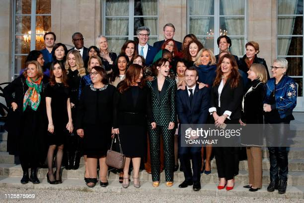 French President Emmanuel Macron gestures as he joins others including Laureates of the 2018 Nobel Peace Prize Congolese Doctor Denis Mukwege and...