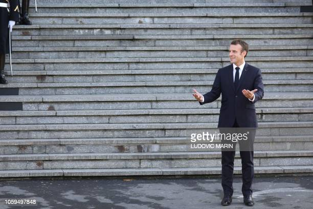French President Emmanuel Macron gestures as he poses for a photograph as he arrives in Albert, northern France on November 9 during a ceremony...