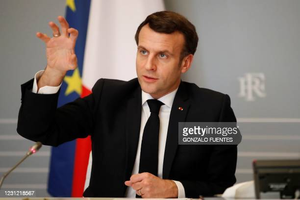 French President Emmanuel Macron gestures as he speaks during a video conference meeting with African Union officials following the ACT-A initiative...