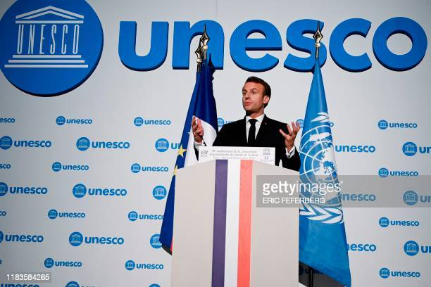 French President Emmanuel Macron gestures as he speaks during the 30th anniversary of the Convention on the Rights of the Child at the UNESCO in...