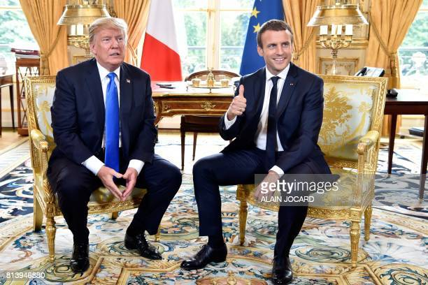 French President Emmanuel Macron gestures during a meeting with US President Donald Trump at the Elysee Palace in Paris on July 13 during Trump's...