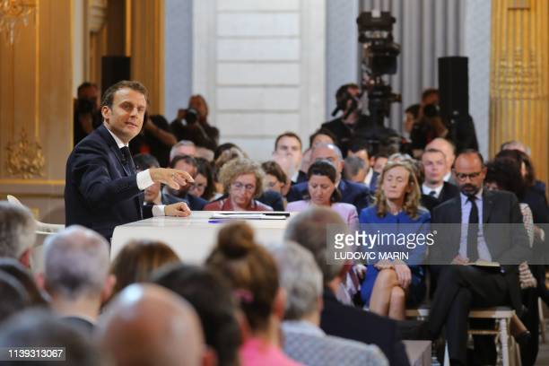 "French President Emmanuel Macron gestures during his live address following the ""Great National Debate"", attended by French Prime Minister Edouard..."