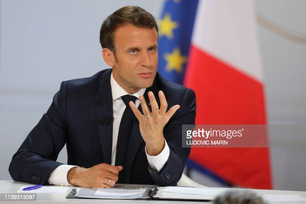 French President Emmanuel Macron gestures during his live address following the Great National Debate at the Elysee Palace in Paris on April 25 2019...