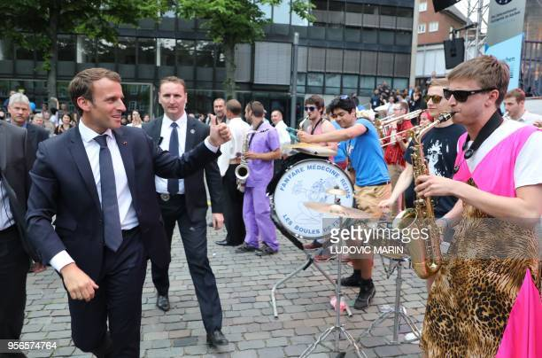 French President Emmanuel Macron gestures to a band during a Charlemagne Prize event in Aachen on May 9 one day before Macron will be awarded with...