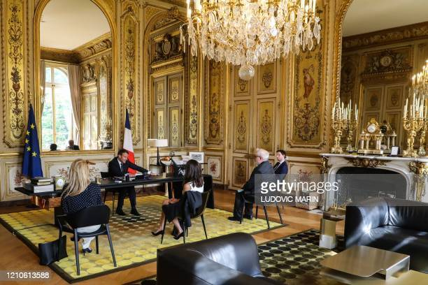 French President Emmanuel Macron gives a phone call to Pope Francis along with his advisors Anne-Sophie Bradelle , Alice Rufo , and Clement Beaune...