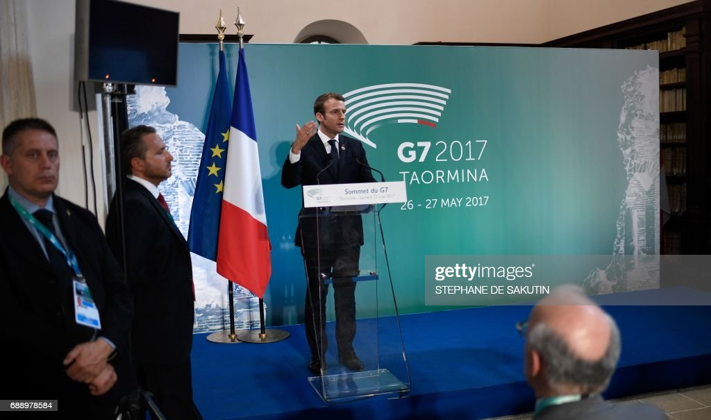 French President Emmanuel Macron gives a press conference at the end of the Summit of the Heads of State and of Government of the G7, the group of most industrialized economies, plus the European Union, on May 27, 2017 in Taormina, Sicily. /