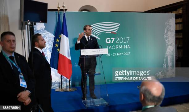 French President Emmanuel Macron gives a press conference at the end of the Summit of the Heads of State and of Government of the G7 the group of...
