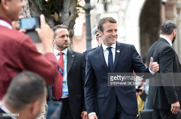 French President Emmanuel Macron gives his thumb up at the end of the Summit of the Heads of State and of Government of the G7 the group of most...