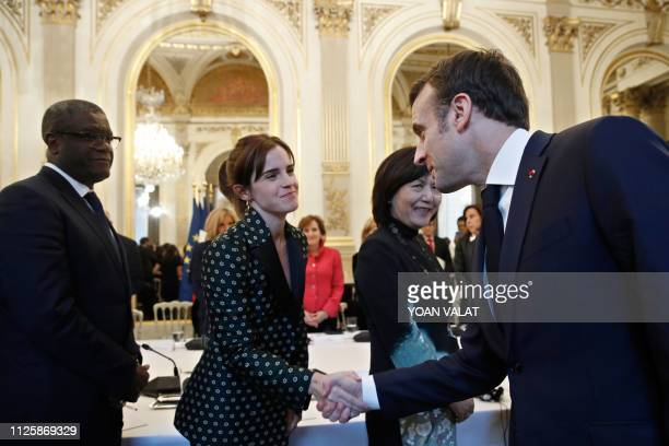 French President Emmanuel Macron greets British actress Emma Watson as he arrives for a meeting for Gender Equality at the Elysee Palace in Paris...