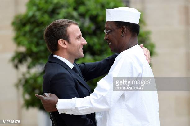 CORRECTION French President Emmanuel Macron greets Chad's President Idriss Deby upon his arrival at the Elysee Presidential Palace in Paris on July...
