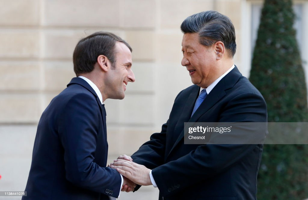FRA: French President Emmanuel Macron Receives Xi Jinping, China's President And His Wife Liyuan Peng At Elysee Palace In Paris
