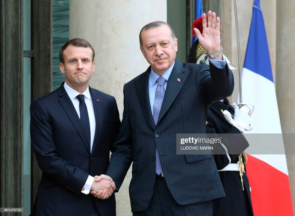 TOPSHOT - French President Emmanuel Macron (L) greets his Turkish counterpart Recep Tayyip Erdogan upon his arrival for their meeting and luncheon on January 5, 2018 at the Elysee palace in Paris. Erdogan will attempt to reset relations with Europe at talks with Macron in Paris on January 5 that are likely to be overshadowed by human rights concerns. /