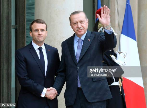 TOPSHOT French President Emmanuel Macron greets his Turkish counterpart Recep Tayyip Erdogan upon his arrival for their meeting and luncheon on...