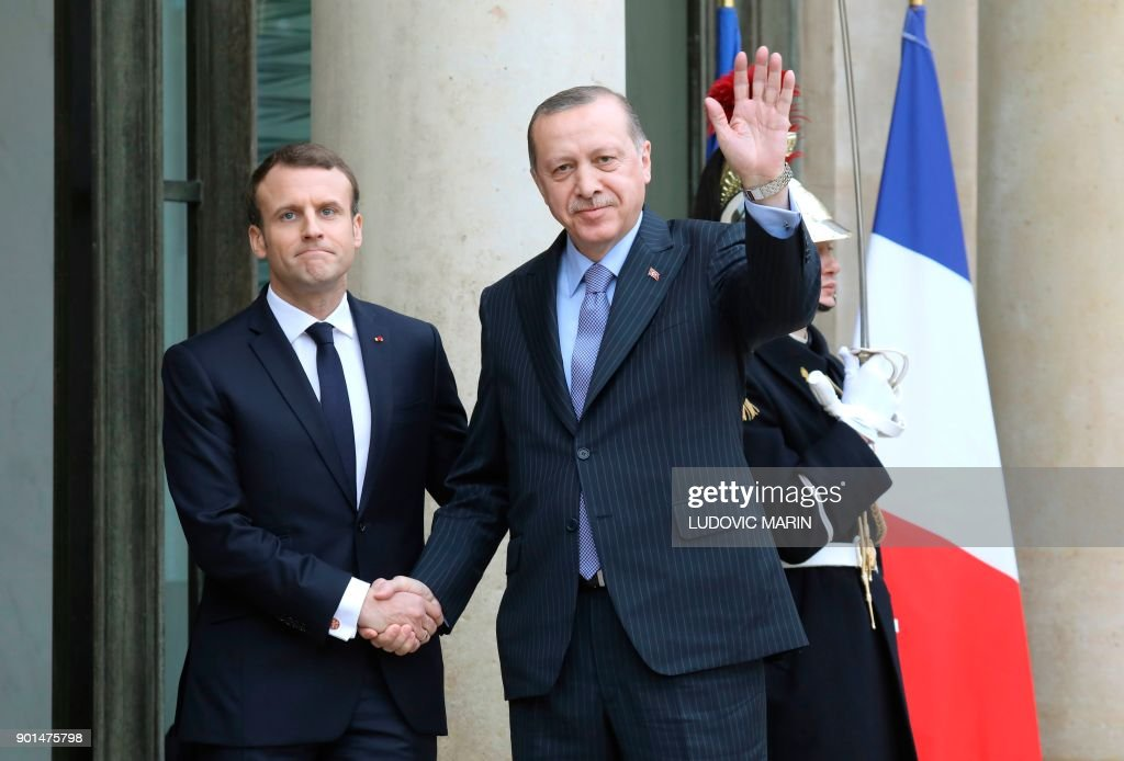 French President Emmanuel Macron (L) greets his Turkish counterpart Recep Tayyip Erdogan upon his arrival for their meeting and luncheon on January 5, 2018 at the Elysee palace in Paris. Erdogan will attempt to reset relations with Europe at talks with Macron in Paris on January 5 that are likely to be overshadowed by human rights concerns. /