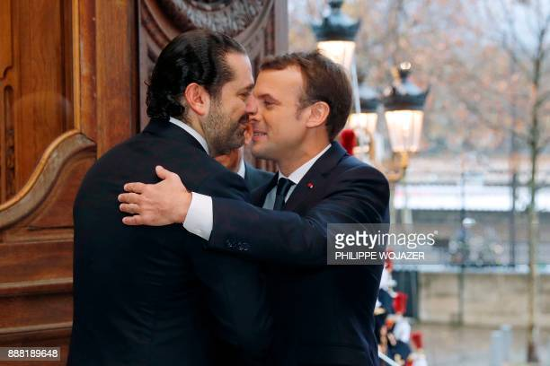 French President Emmanuel Macron greets Lebanon's Prime Minister Saad Hariri as they arrive to attend the Lebanon International Support Group meeting...