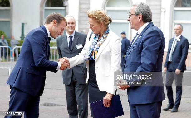 French President Emmanuel Macron greets Marija Pejcinovic Buric, Secretary General of the Council of Europe, flanked by Strasbourg Mayor Roland Ries...
