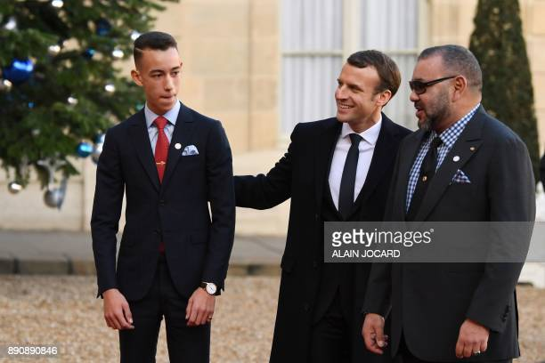 French President Emmanuel Macron greets Mohammed VI of Morocco and Moulay Hassan Crown Prince of Morocco as they arrive at the Elysee palace on...