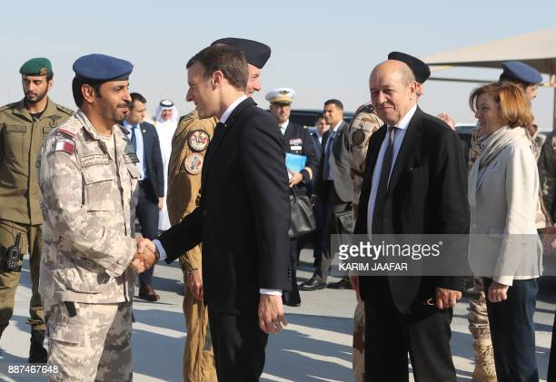 French President Emmanuel Macron greets Qatari armed forces commander Zafer alHababi near French Foreign Minister JeanYves Le Drian upon their...
