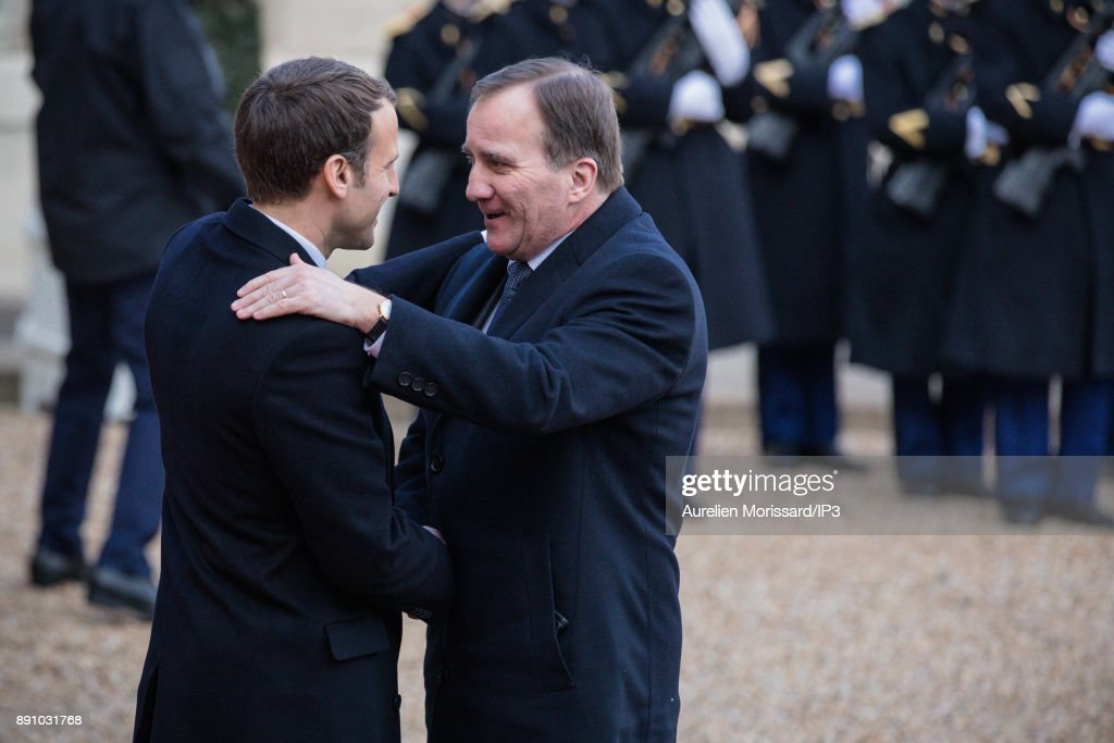 French President Emmanuel Macron (L) greets Sweden's Prime Minister Stefan Lofven (R) as he arrives at the Elysee Palace for a lunch as part of the One Planet Summit on December 12, 2017 in Paris, France.