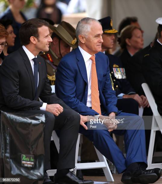French President Emmanuel Macron grips the leg of Australian Prime Minister Malcolm Turnbull during war commemorative ceremony on May 2 2018 in...