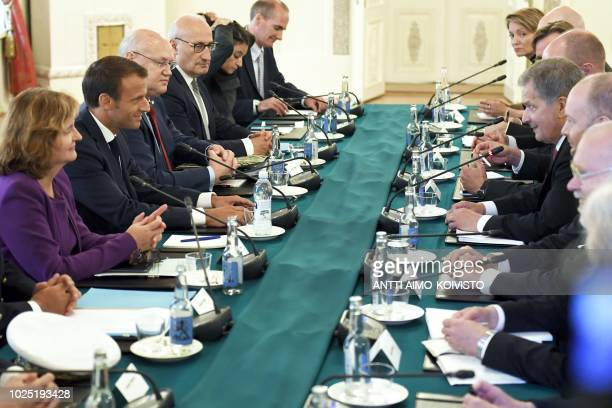 French President Emmanuel Macron has taken seat to talk with the Finnish President Sauli Niinistö and delegation members during their meeting at the...