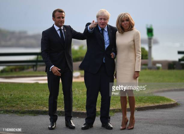 French President Emmanuel Macron , his wife Brigitte Macron and British Prime Minister Boris Johnson pose for a photograph as they arrive for the G7...