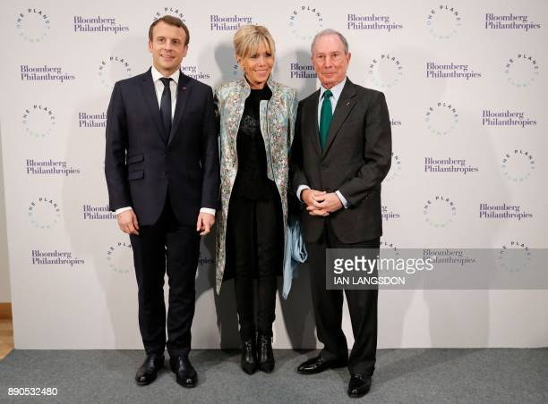 French President Emmanuel Macron his wife Brigitte Macron and former New York mayor and United Nations special envoy for cities and climate change...