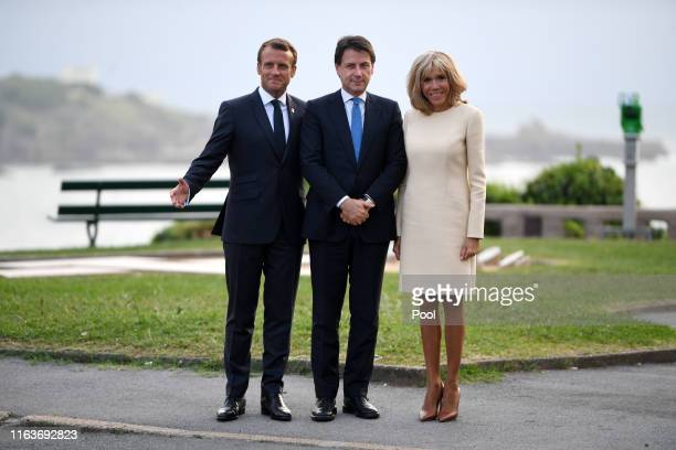 French President Emmanuel Macron his wife Brigitte Macron and Italian Prime Minister Giuseppe Conte pose for a photograph ahead of a working dinner...