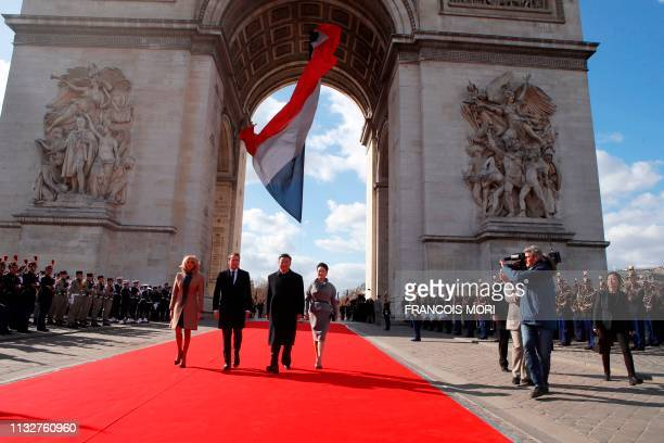 French President Emmanuel Macron his wife Brigitte Macron Chinese President President Xi Jinping and his wife Peng Liyuan leave the Arc de Triomphe...