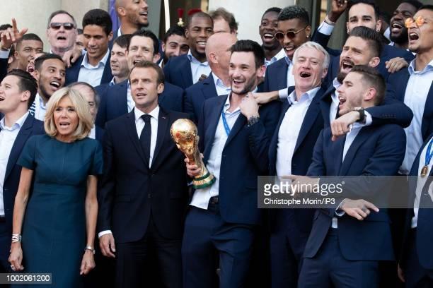 French president Emmanuel Macron his wife Brigitte Macron France's coach Didier Deschamps France's goalkeeper Hugo Lloris pose for a family photo at...