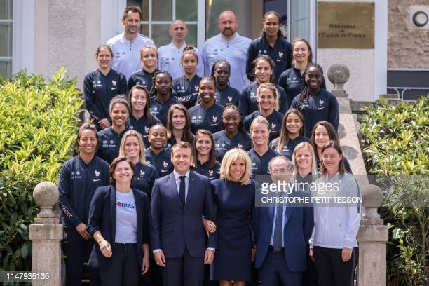 French President Emmanuel Macron his wife Brigitte Macron French Sport Minister Roxana Maracineau France's national women's football team's head...