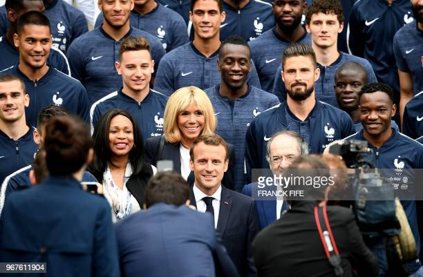 TOPSHOT French President Emmanuel Macron his wife Brigitte Macron French Sports Minister Laura Flessel and French Football Federation President Noel...