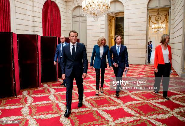 French president Emmanuel Macron his wife Brigitte Macron French TV host cultural heritage adviser Stephane Bern and French Culture Minister...