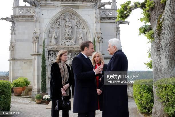 French President Emmanuel Macron his wife Brigitte Macron Italian President Sergio Mattarella and his daughter Laura Mattarella talk during a visit...