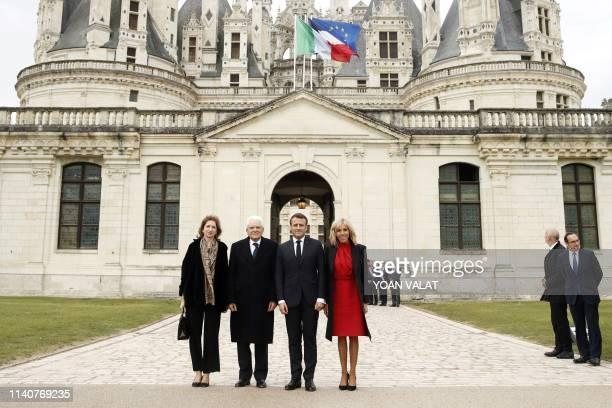 French President Emmanuel Macron , his wife Brigitte Macron , Italian President Sergio Mattarella and his daughter Laura Mattarella pose for...