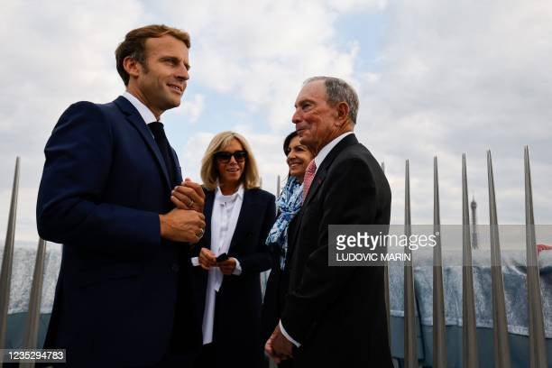 French President Emmanuel Macron, his wife Brigitte Macron, Paris Mayor and Socialist Party candidate for the 2022 French presidential elections Anne...
