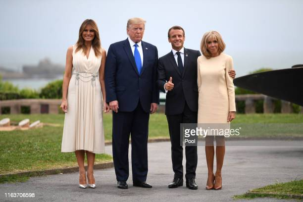 French President Emmanuel Macron his wife Brigitte Macron US President Donald Trump and his wife US First Lady Melania Trump pose for a photograph...