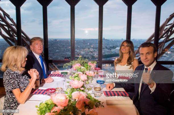 French President Emmanuel Macron his wife Brigitte Macron US President Donald Trump and First Lady Melania Trump pose ahead of a dinner at Le Jules...