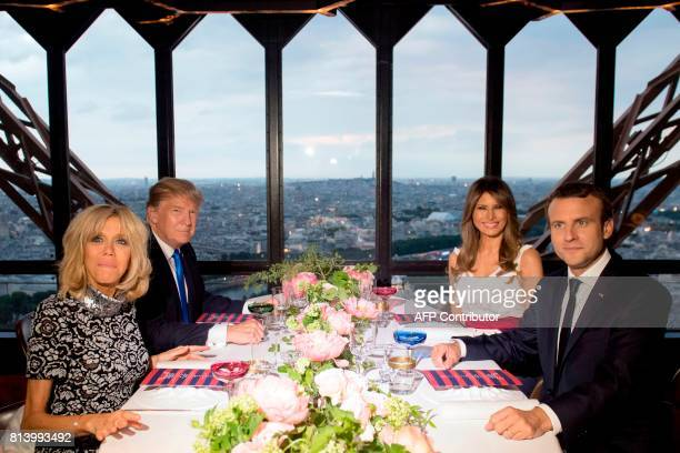 TOPSHOT French President Emmanuel Macron his wife Brigitte Macron US President Donald Trump and First Lady Melania Trump attend a dinner at Le Jules...