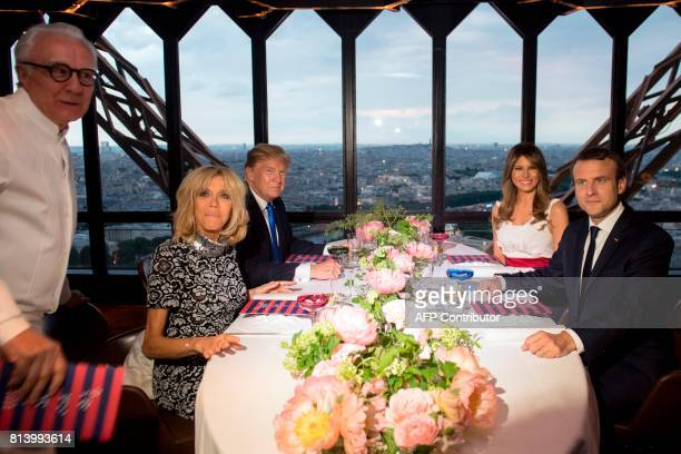 French President Emmanuel Macron his wife Brigitte Macron US President Donald Trump and First Lady Melania Trump pose with French chef Alain Ducasse...